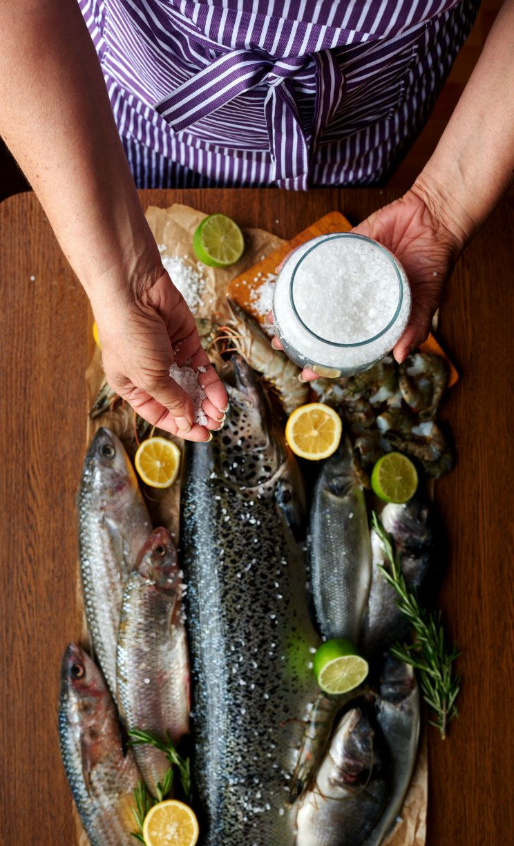 woman-salting-fresh-fish